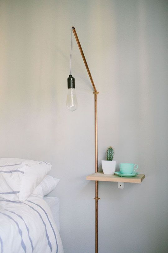tiny nightstand piece attached to the wall