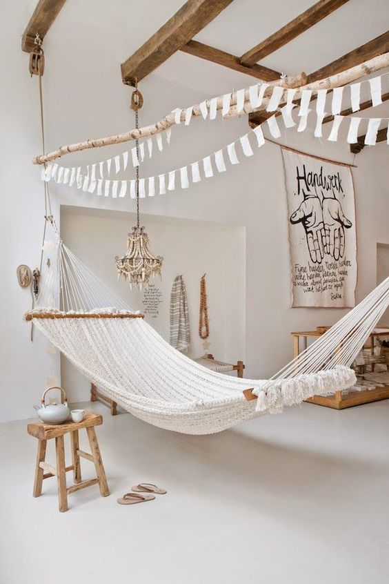 simple white fabric hammock in a light-filled space