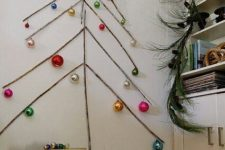 15 sticks attached to the wall and ornaments hanging on them