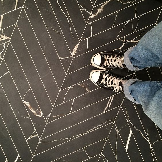 chevron floor tiles with a stone imitating pattern