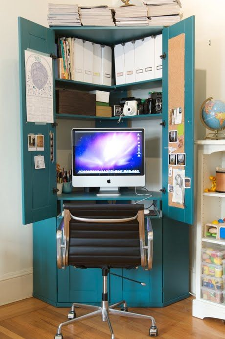corner armoire hiding a desk