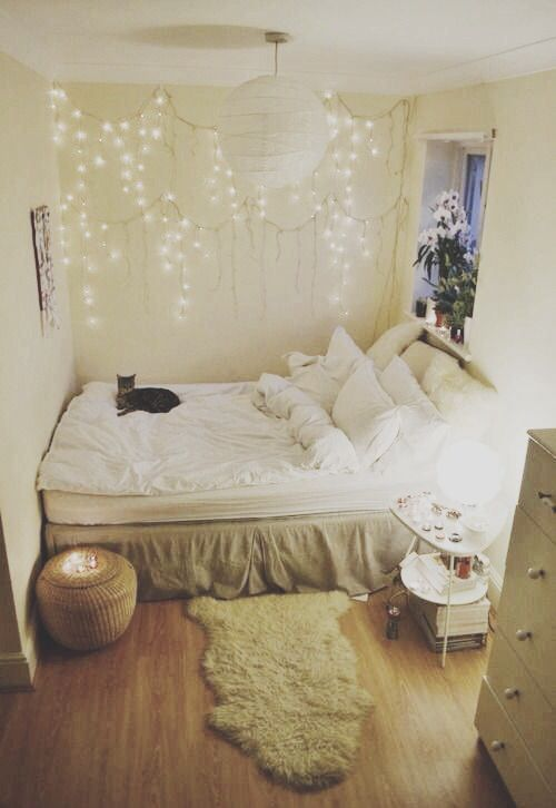 string lights on the wall over the bed