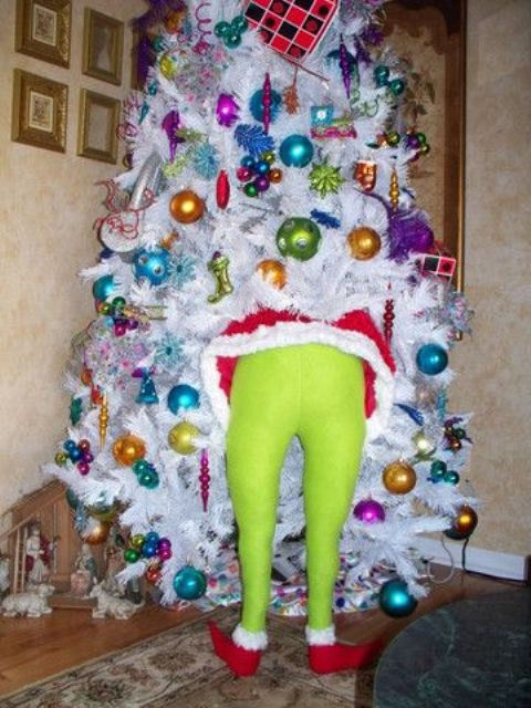 ugly sweater party tree with a Grinch decoration