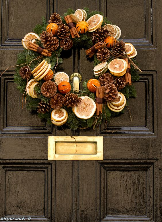 cinnamon, pinecones, dried citrus and evergreen wreath