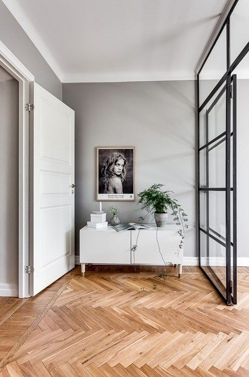 warm wood floors with a chevron pattern
