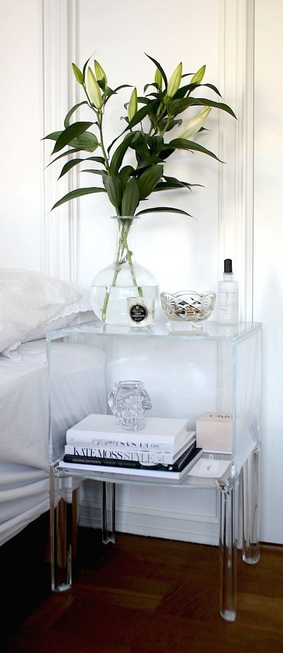 an acrylic nightstand will visually take no space