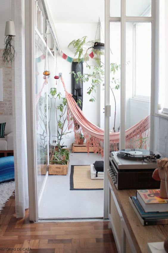separate a nook from the rest of the room, put potted plants and hang a hammock