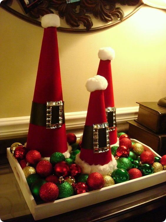 Santa cones display on a tray with colorful ornaments