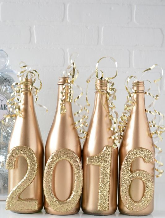 gold and glitter bottles can be used as vases for centerpieces