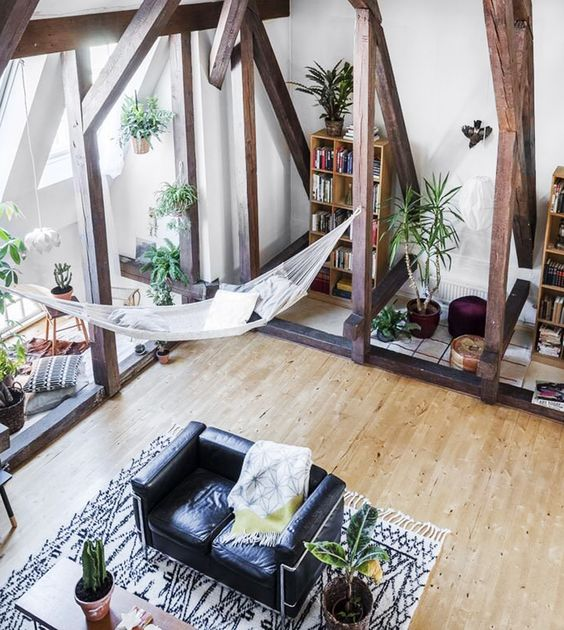 modern open-layout space with a white hammock bed