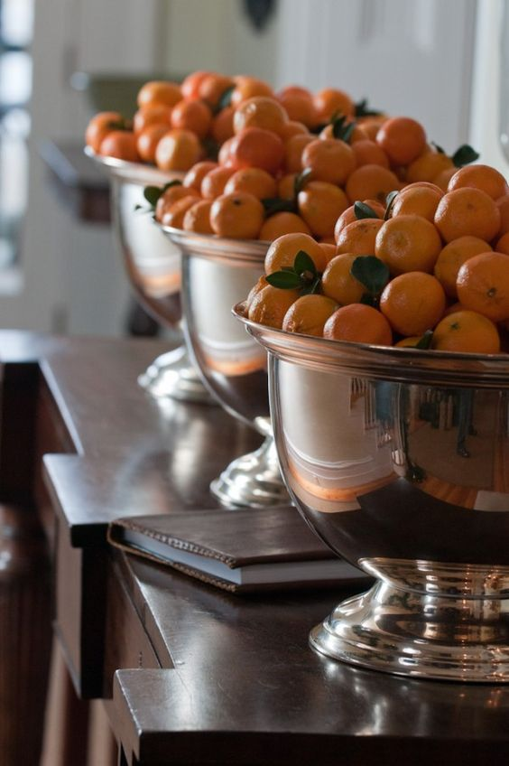 oranges in metallic bows for an entry display