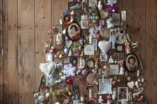 19 vintage frames and ornaments form a tree on the wall