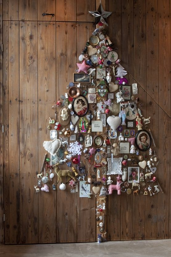vintage frames and ornaments form a tree on the wall
