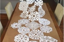 20 paper snowflake table runner is an easy craft