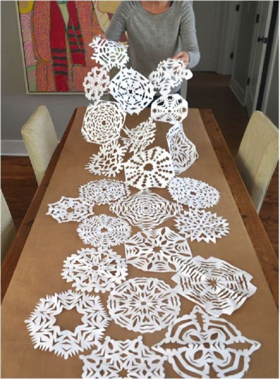 paper snowflake table runner is an easy craft