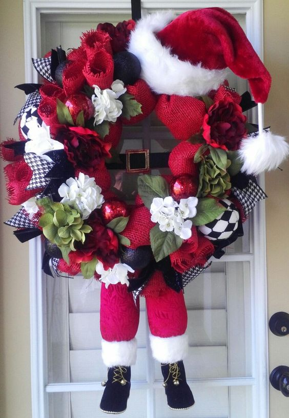 vibrant Santa-themed wreath with legs and a hat