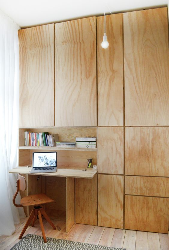 wooden cabinets that hide a desktop