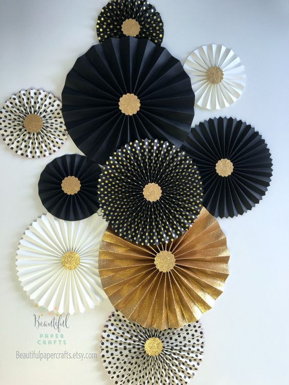 oversized paper fans to decorate walls