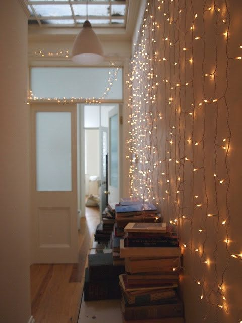 drape string lights along a wall to make the whole place shimmer like the stars