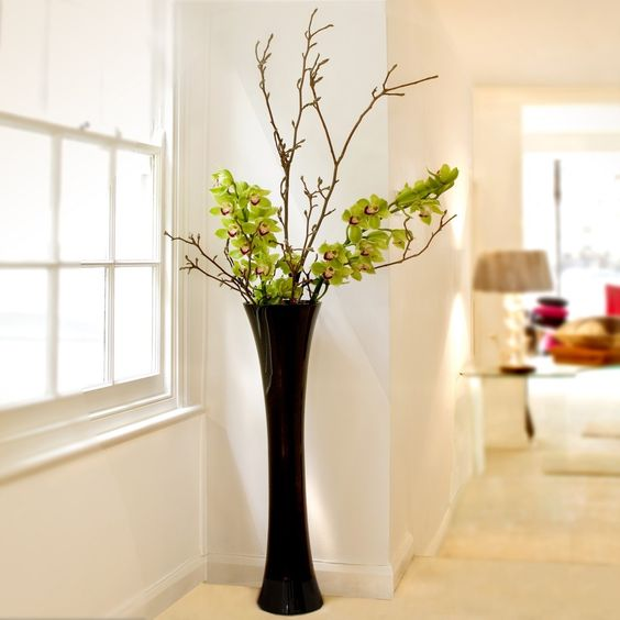 modern black floor vase with greenery and branches