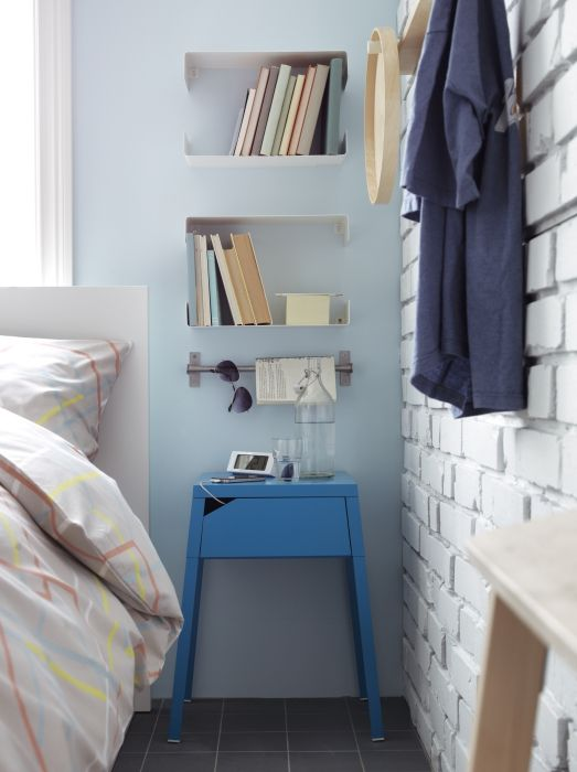 small IKEA nightstand and bookshelf units hanging over it