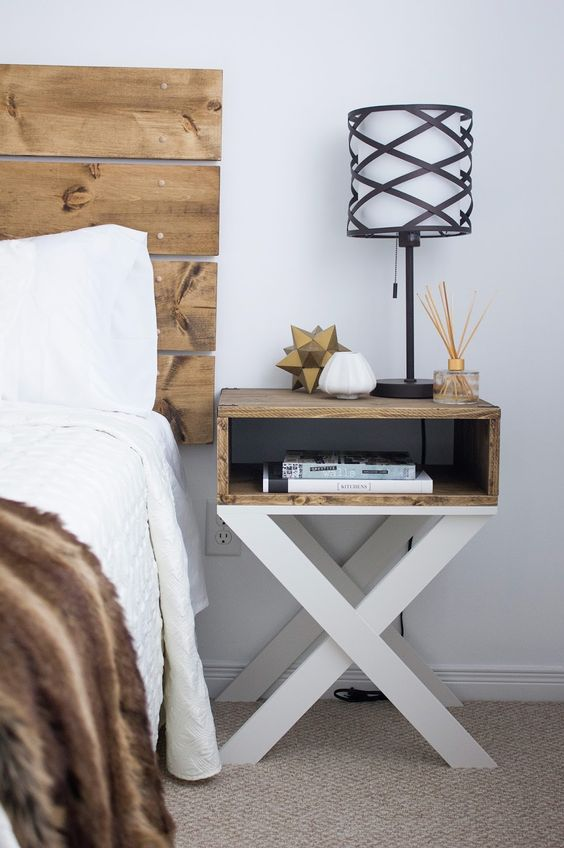 small ikea nightstand and bookshelf units hanging over it stained wood drawer on criss cross legs