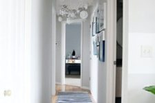 24 white paper snowflakes hanging in the hallway