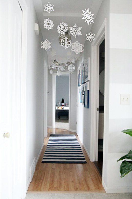 white paper snowflakes hanging in the hallway
