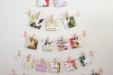 26 Christmas cards hanging on strings