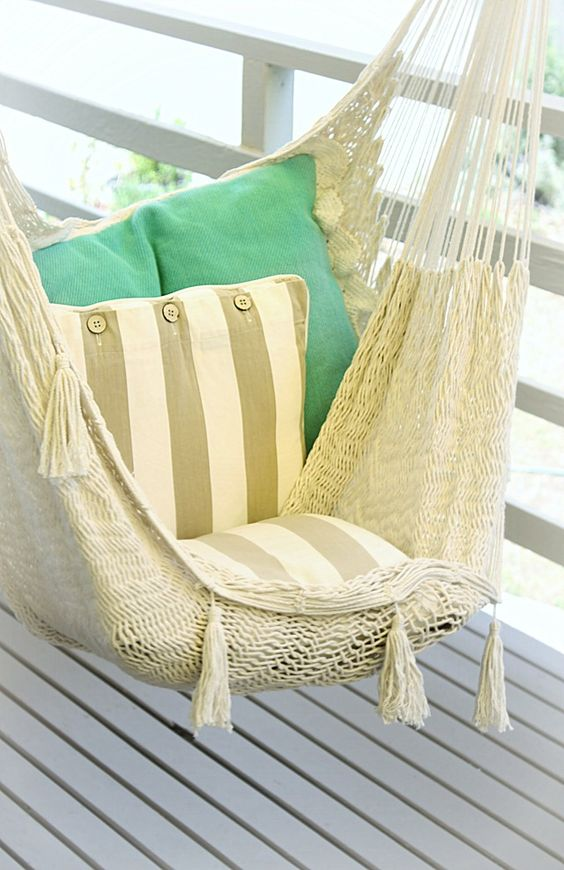 macrame hammock chair with pillows is a comfortable piece