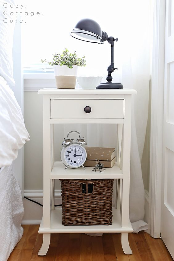 white cottage-style nightstand with several layers for storage