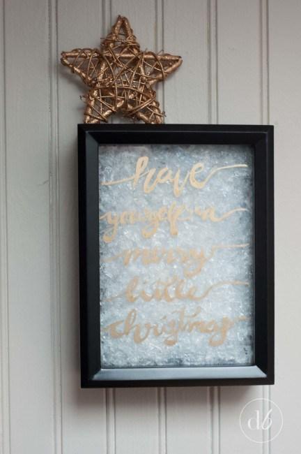 DIY Christmas shadow box with faux snow (via www.dwellbeautiful.com)