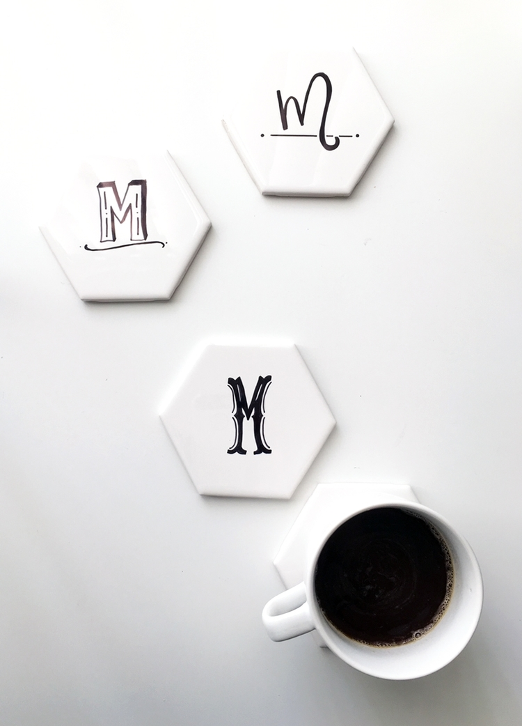 DIY hexagon tile coasters decorated with a black marker (via www.drawntodiy.com)