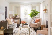 02 a neutral color palette with warm shades makes this living room cozy and visually bigger