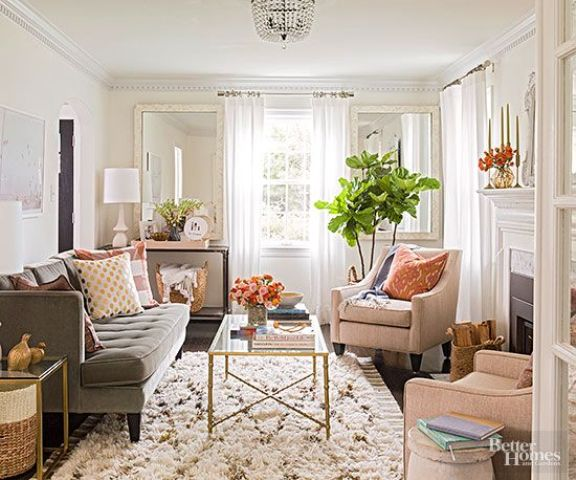 a neutral color palette with warm shades makes this living room cozy and visually bigger