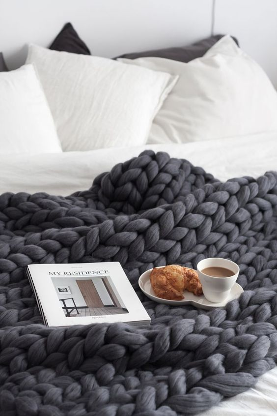 black chunky knit blanket to keep you cozy and warm while sleeping