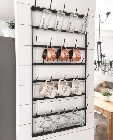 black metal shelf with hooks for mugs