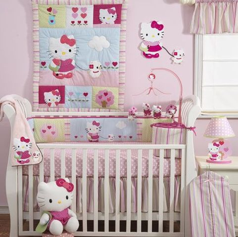 light pink nursery decor with themed textiles and prints
