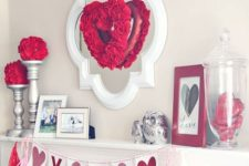 02 mantel decor with a heart-shaped wreath, an XO banner and sequins