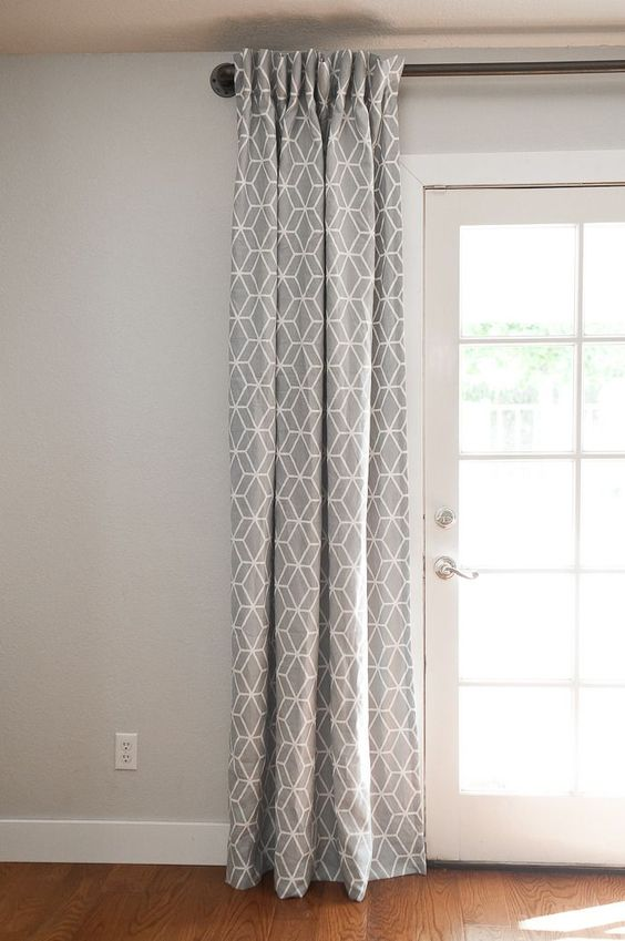 Patterned Grey Curtains Over The French Doors