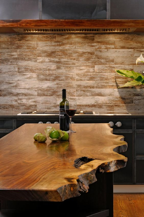 this kitchen island strikes with its raw edge and looks refined