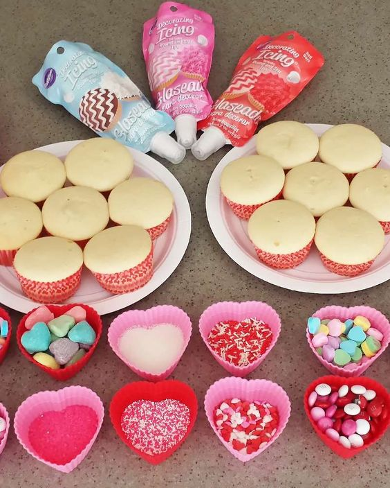 cupcake decorating bar at a Valentine's Day party