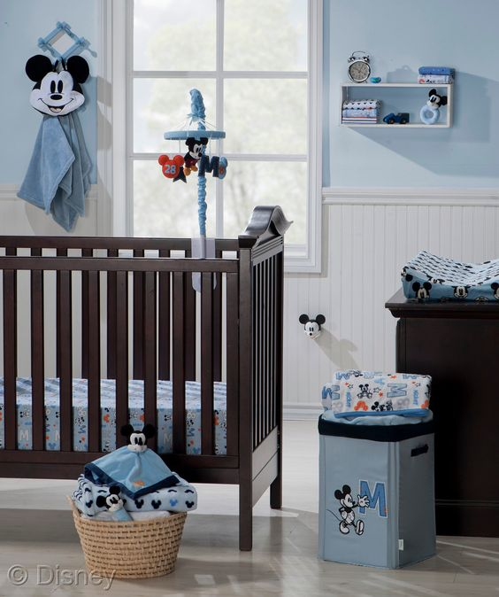 light blue Mickey Mouse nursery, dark furniture and baskets