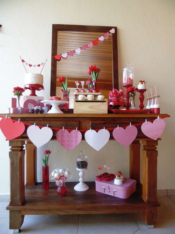simple paper heart garlands and banners and red candle sticks will help you with decor