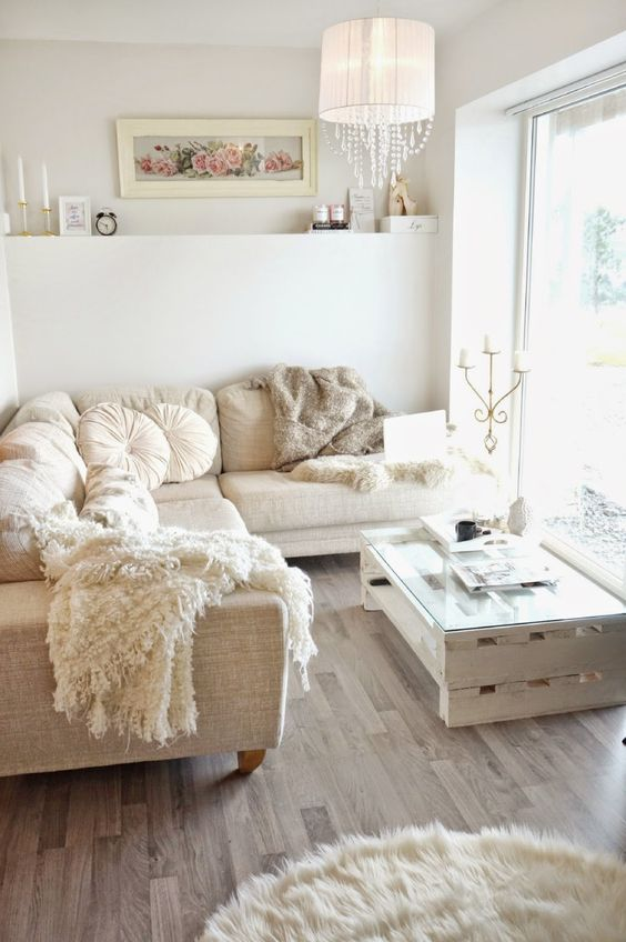 comfy white and neutral living room with lighht brown floor