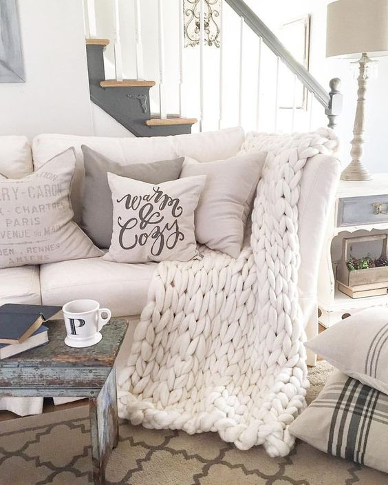 white chunky knit blanket will keep you warm in the living room
