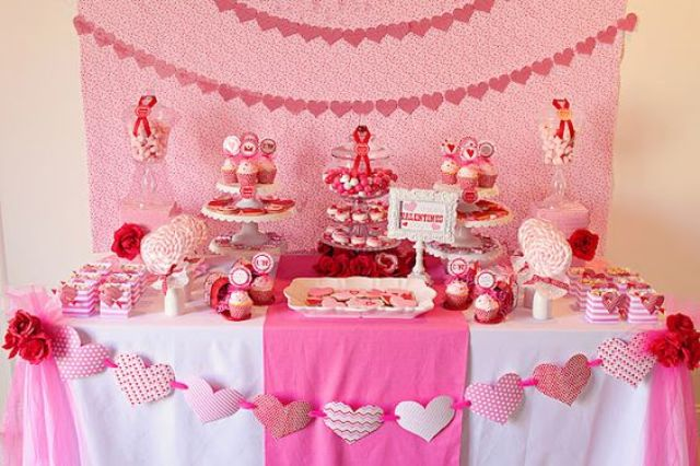 all-pink dessert table decor and heart garlands