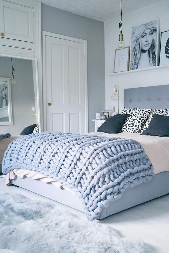 this blue chunky knit bedspread fits the room decor perfectly