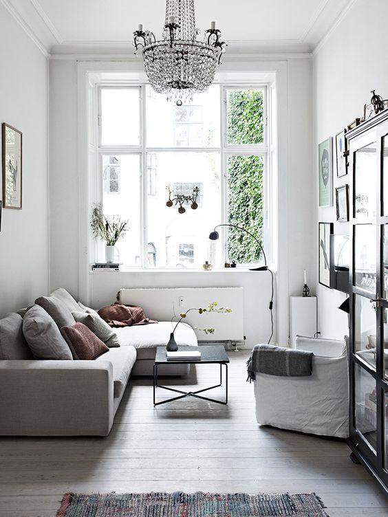 Scandinavian-inspired living room in light grey and white