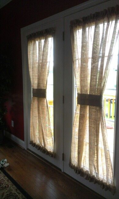 burlap curtains attached in bow shape to the doors